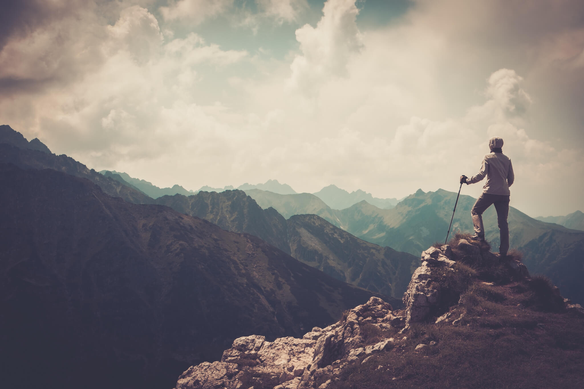 Woman hiker on top of a mountain